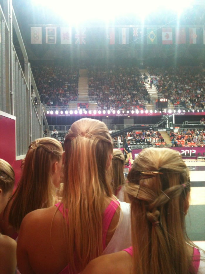 Standing Behind Cheerleaders