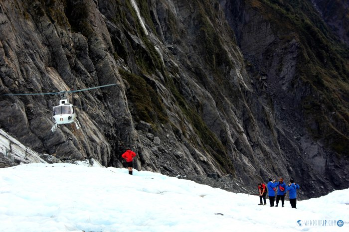 The helicopter departs the glacier