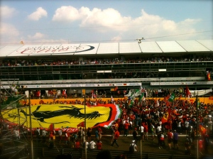 The tifosi swarm the circuit after the race