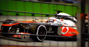 Jenson Button heading over the bridge