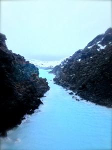 A dramatic arctic landscape surrounds the lagoon